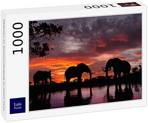 Lais Puzzle Elefanten im Sonnenuntergang an einem Fluss 1000 Teile